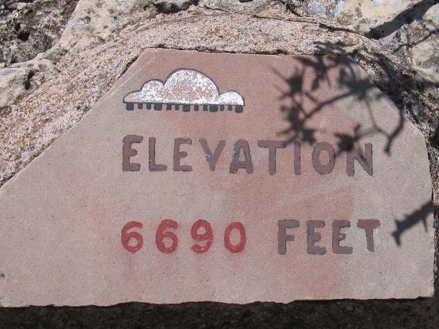 Height marker at Walnut Canyon - over a mile above sea level
